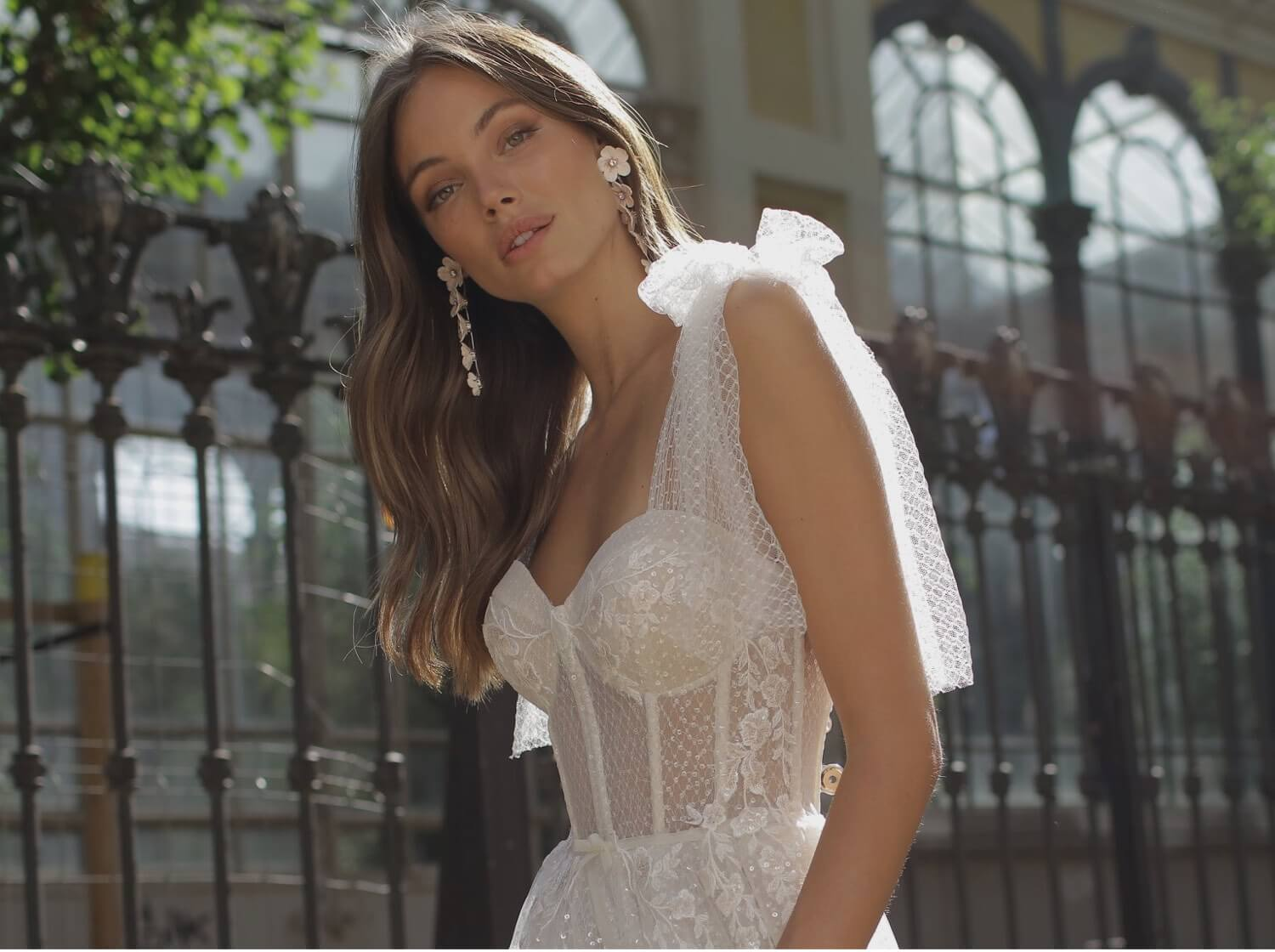 Model wearing a white bridal gown by Berta