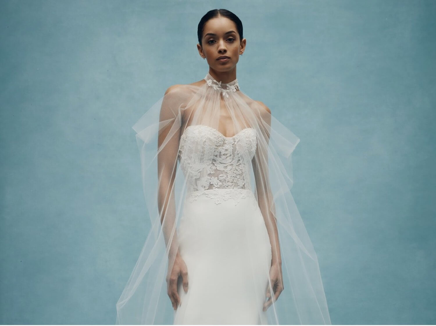 Model wearing a white bridal gown by Anne Barge